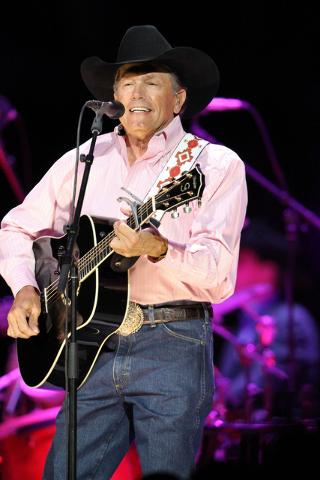 George Strait performing at Philips Arena on Saturday, Mar. 22, 2014, in Atlanta. (Photo by Robb D. Cohen/Invision/AP)