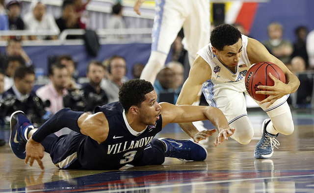 North Carolina's Marcus Paige battles for a loose ball against Villanova's Josh Hart (3) during the second half of the NCAA Final Four tournament college basketball championship game Monday, April ...