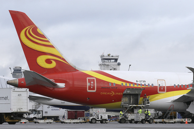 A Boeing 787 operated by Hainan Airlines is loaded with cargo Tuesday, Jan. 26, 2016, at Seattle-Tacoma International Airport in Seattle. (Ted S. Warren/AP)