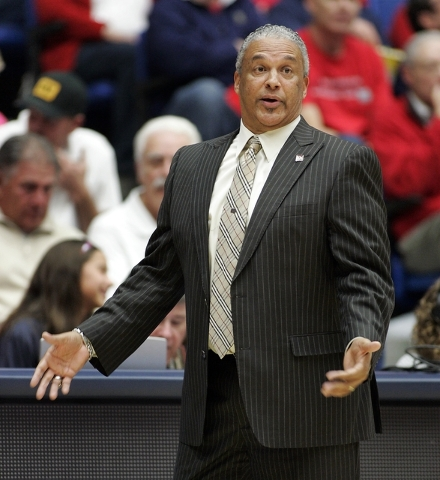 New Mexico States' head coach Marvin Menzies gestures to an official about a call in the first half against Arizona of an NCAA college basketball game on Wednesday, Dec. 11, 2013 in Tucson, Ariz.  ...
