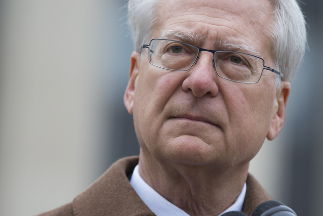 Lawyer Larry Klayman speaks to reporters outside the E. Barrett Prettyman Federal Courthouse, on Monday, Dec. 22, 2014, in Washington. (AP Photo/Evan Vucci)