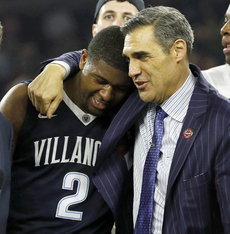 Villanova head coach Jay Wright, right, embraces Kris Jenkins after Jenkins scored a game winning three point basket in the closing seconds of the NCAA Final Four tournament college basketball cha ...