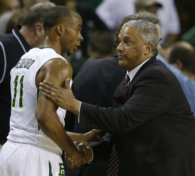 New Mexico State head basketball coach Marvin Menzies, right, shakes hands with Baylor guard Lester Medford (11), left, following of an NCAA college basketball game, Wednesday, Dec. 23, 2015, in W ...