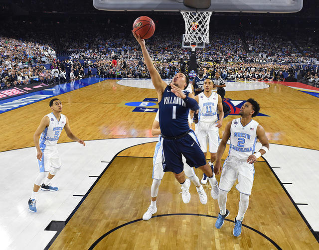 Villanova's Jalen Brunson (1) goes to the basket during the first half of the NCAA Final Four tournament college basketball championship game against North Carolina, Monday, April 4, 2016, in Hous ...