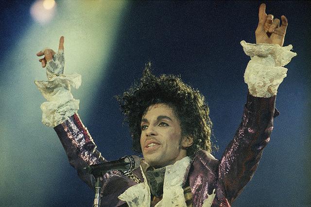 Rock singer Prince performs at the Forum in Inglewood, Calif., during his opening show, Feb. 18, 1985. (AP Photo/Liu Heung Shing)
