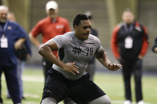Notre Dame's Ronnie Stanley runs a drill during Notre Dame's NFL football Pro Day in South Bend, Ind., Thursday, March 31, 2016. (AP Photo/Michael Conroy)
