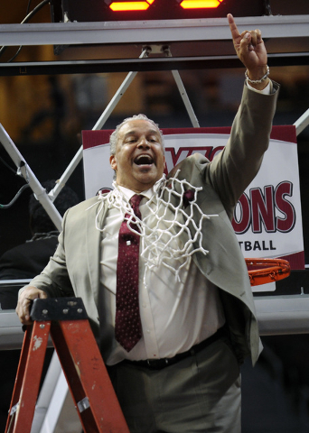 New Mexico State coach Marvin Menzies celebrates after his team defeated Idaho 77-55 in an NCAA college basketball game for the championship in the Western Athletic Conference men's tournament, Sa ...