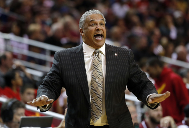 New Mexico State head coach Marvin Menzies gives instructions to his players from the sidelines during the first half of an NCAA college basketball game against New Mexico in Las Cruces, N.M., Sat ...