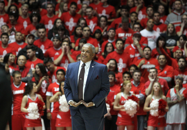 New Mexico State head coach Marvin Menzies reacts in the final minutes of an NCAA college basketball game against New Mexico, Wednesday, Dec. 3, 2014, in Albuquerque, N.M. (AP Photo/Mark Holm)