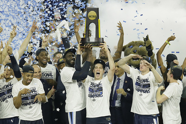 Villanova players celebrate after the NCAA Final Four tournament college basketball championship game against North Carolina, Monday, April 4, 2016, in Houston. Villanova won 77-74. (AP Photo/Char ...