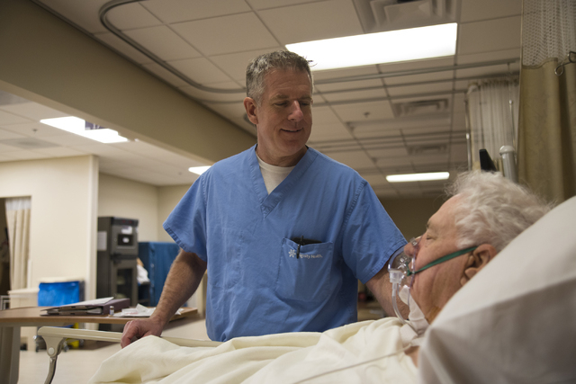 Don Fox, right, recovers from his surgery as his surgeon, Dr. Frederick Goll, stands at his bedside at St. Rose Dominican Hospital's Siena Campus in Henderson on Friday, April 8, 2016. (Daniel Cla ...