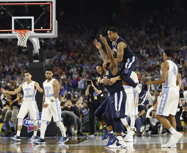 Villanova players celebrate after the NCAA Final Four tournament college basketball championship game against North Carolina, Monday, April 4, 2016, in Houston. Villanova won 77-74.(AP Photo/David ...