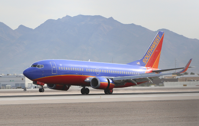 A Southwest Airlines jet lands at McCarran International Airport Monday, April 4, 2016. Bizuayehu Tesfaye/Las Vegas Review-Journal Follow @bizutesfaye