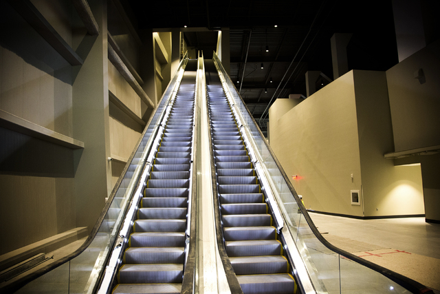 A escalator leading to the upper concourse is seen  Monday, March 7, 2016 at the T-Mobile Arena behind New York-New York. The joint venture partners AEG and MGM Resorts is scheduled to open the ar ...