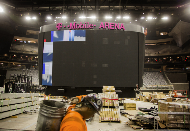 The scoreboard is seen Monday, March 7, 2016 at the T-Mobile Arena behind New York-New York. The joint venture partners AEG and MGM Resorts is scheduled to open the arena next month. Jeff Scheid/L ...