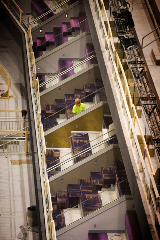 A man works on a suite at the T-Mobile Arena behind New York-New York on  Monday, March 7, 2016. The joint venture partners AEG and MGM Resorts is scheduled to open the arena next month. Jeff Sche ...
