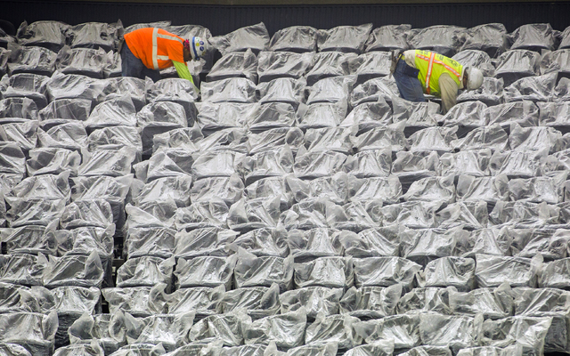 Men work on seating at the T-Mobile Arena behind New York-New York on Monday, March 7, 2016. The joint venture partners AEG and MGM Resorts is scheduled to open the arena next month. Jeff Scheid/L ...