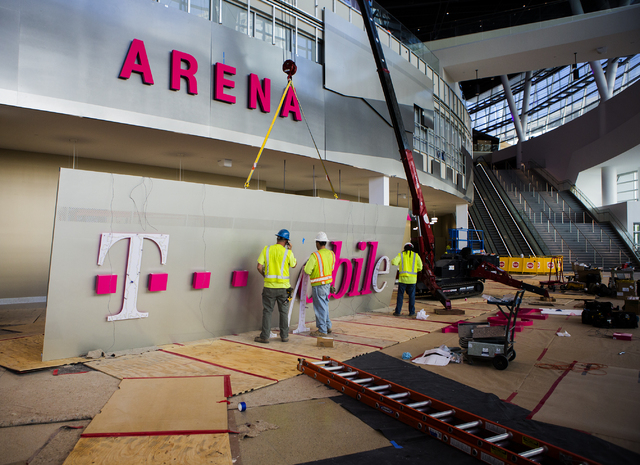 Men work on a sign inside T-Mobile Arena on Thursday, March 24, 2016. Jeff Scheid/Las Vegas Review-Journal Follow @jlscheid