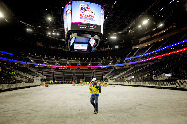 A man walks below the scoreboard at the T-Mobile Arena on Monday, March 28, 2016. Jeff Scheid/Las Vegas Review-Journal Follow @jlscheid