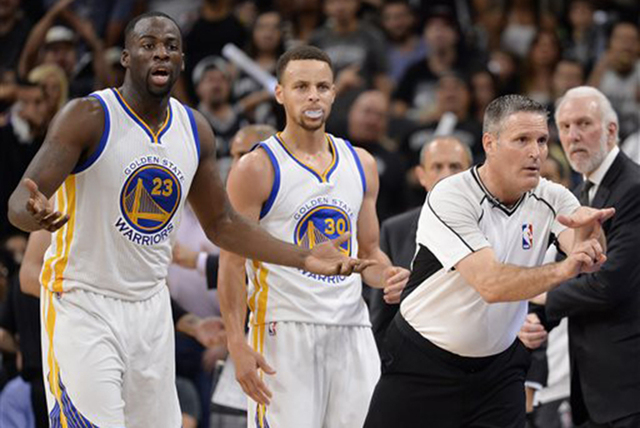 Referee Monty McCutchen, front right, calls a technical foul on Golden State Warriors forward Draymond Green (23) during the first half of an NBA basketball game against the San Antonio Spurs, Sun ...