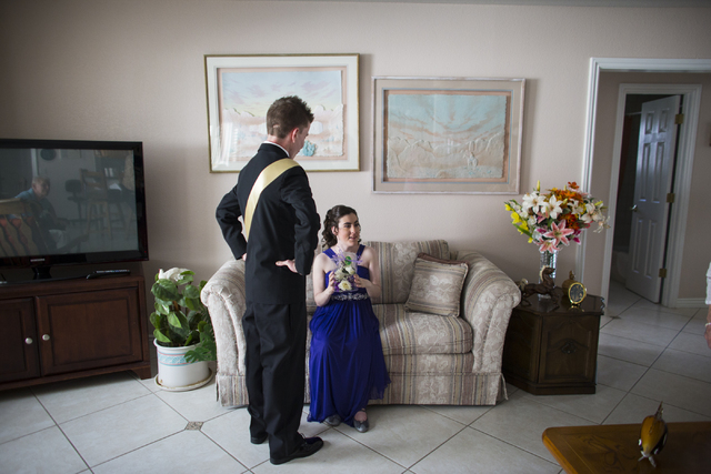 Blake Hernandez, left, greets Larissa Evans ahead of their high school prom night in Henderson on Saturday, April 16, 2016. Evans and Hernandez, both of whom are special needs students at Basic Hi ...
