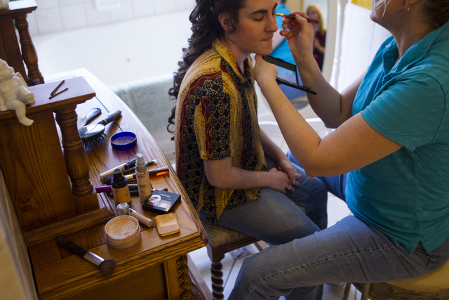 Cheryl Chauncy, right, does makeup for Larissa Evans ahead of Evans' high school prom in Henderson on Saturday, April 16, 2016.  (Chase Stevens/Las Vegas Review-Journal) Follow @csstevensphoto