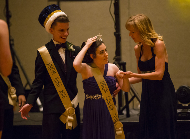 Blake Hernandez and Larissa Evans are crowned prom king and queen as special education teacher Jill Spatafore assists Evans stands during high school prom night at the Westin Lake Las Vegas in Hen ...