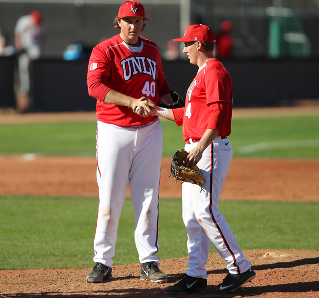 UNLV pitcher D.J. Myers (40), left, handshakes with Morgan Stotts (44), as he is substituted out of the game in the eight inning during their baseball game against Nebraska at Wilson Stadium in La ...