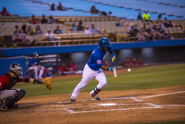 Dilson Herrera, 2, of the Las Vegas 51's, bunts during baseball action against the Albuquerque Isotopes at Cashman Field in Las Vegas on Sunday, July 5, 2015. (Joshua Dahl/Las Vegas Review-Journal)