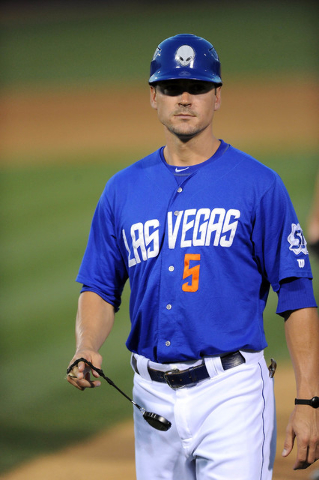 Las Vegas infielder Matt Reynolds, who was not in the starting line-up, is seen coaching first base in the fourth inning of their Triple-A minor league baseball game against the Sacramento River C ...