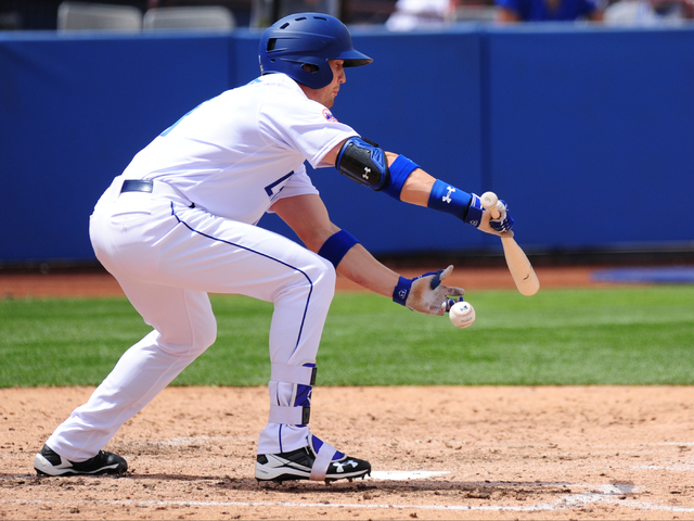 Las Vegas 51s batter Brandon Nimmo is hit by a pitch while bunting an Albuquerque pitch in the fourth inning of their Triple-A minor league baseball game at Cashman Field. (Josh Holmberg/Las Vegas)