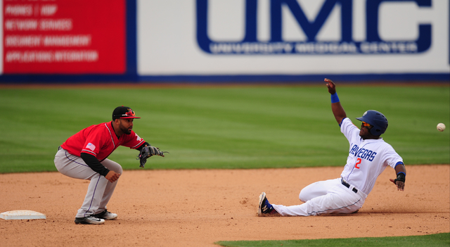 Las Vegas 51s base runner Dilson Herrera is tagged out by Albuquerque second baseman Rafael Ynoa after Herrera tried to steal second base in the seventh inning of their Triple-A minor league baseb ...
