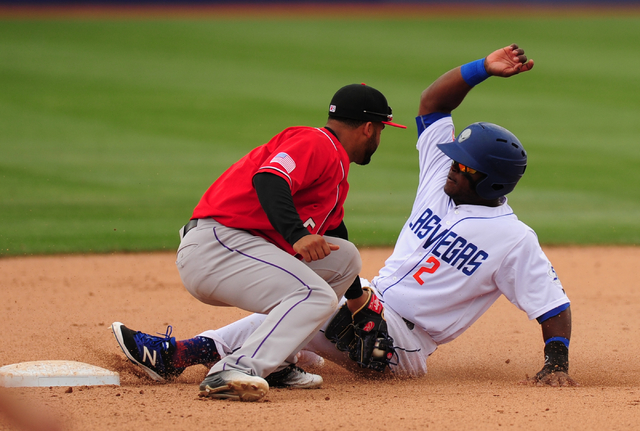 Las Vegas 51s base runner Dilson Herrera is tagged out by Albuquerque second baseman Rafael Ynoa after Herrera tried to steal second base at Cashman Field in Las Vegas Sunday, April 24, 2016.  (Jo ...