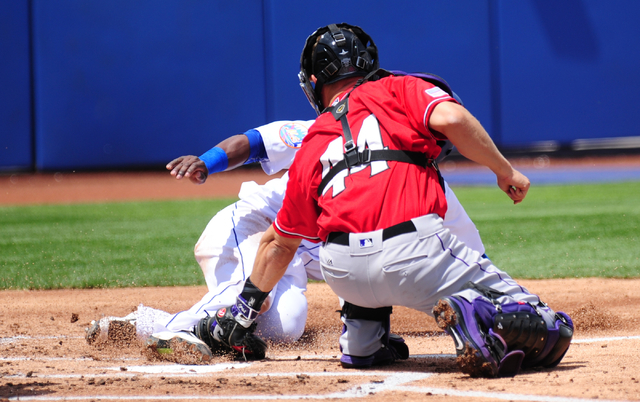 Albuquerque catcher Nick Hundley tags out Las Vegas 51s base runner Roger Bernadina at home plate in the first inning of their Triple-A minor league baseball game at Cashman Field. (Josh Holmberg/ ...