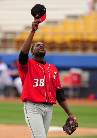 Albuquerque Isotopes closer Simon Castro points to the sky after earning the save against the Las Vegas 51s during their Triple-A minor league baseball game at Cashman Field in Las Vegas Sunday, A ...