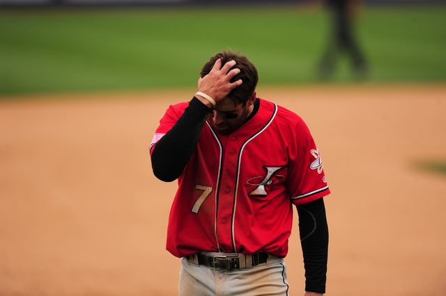 Albuquerque Isotopes base runner Stephen Cardullo reacts after getting caught in a Las Vegas 51s double play in the seventh inning of their Triple-A minor league baseball game at Cashman Field in  ...