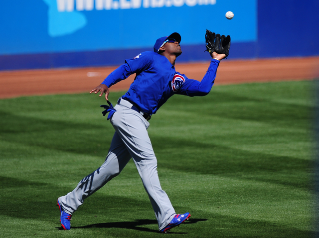 Chicago Cubs left fielder Jorge Soler catches a New York Mets fly ball in the fifth inning of their MLB preseason baseball game at Cashman Field in Las Vegas Friday, April 1, 2016. The Mets defeat ...