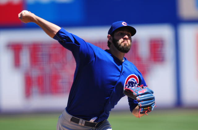 Chicago Cubs starting pitcher Jason Hammel delivers to the New York Mets in the second inning of their MLB preseason baseball game at Cashman Field in Las Vegas Friday, April 1, 2016. The Mets def ...