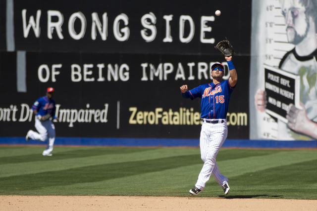 New York Mets Matt Reynolds (15) makes a catch for an out in their baseball game against the Chicago Cubs during Big League Weekend at Cashman Field on Friday, April 1, 2016, in Las Vegas. The Met ...
