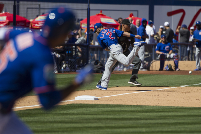 Chicago Cubs Tommy La Stella (2) is late to the ball for a New York Mets single in their baseball game during Big League Weekend at Cashman Field on Friday, April 1, 2016, in Las Vegas. The Mets w ...