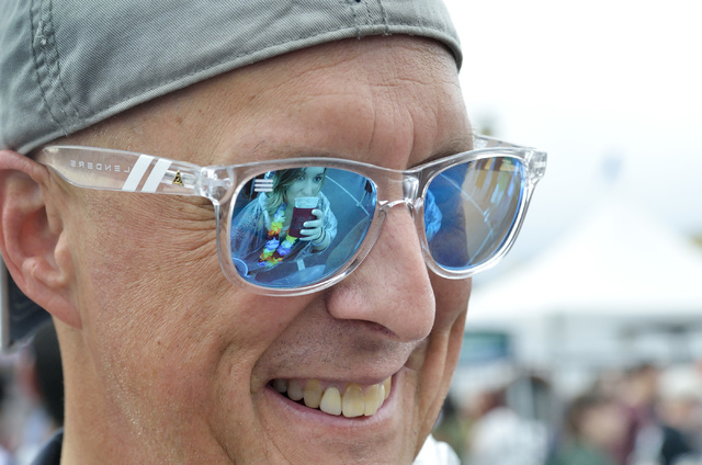 Jessica Ernsperger is reflected in her father Tom Ernsperger's glasses during the Great Vegas Festival of Beer in the 800 block of Fremont Street in Las Vegas on Saturday, April 9, 2016. Bi ...