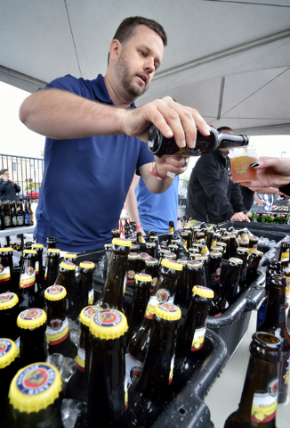 David Towill pours a beer at the Paulaner Brewing Company tent during the Great Vegas Festival of Beer in the 800 block of Fremont Street in Las Vegas on Saturday, April 9, 2016. Bill Hughes/Las V ...