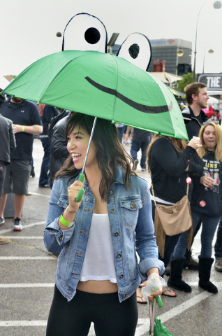 Vivi Avila waits in the line for the Lagunitas Brewing Company during a rainy afternoon at the Great Vegas Festival of Beer in the 800 block of Fremont Street in Las Vegas on Saturday, April 9, 20 ...