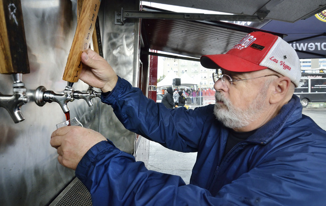 Wayne Bach pulls a beer at the Chicago Brewing Company tent during the Great Vegas Festival of Beer in the 800 block of Fremont Street in Las Vegas on Saturday, April 9, 2016. Bill Hughes/Las Vega ...