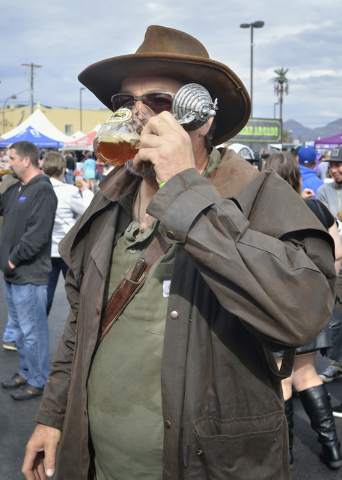 Steve Burcham samples a beer during the Great Vegas Festival of Beer in the 800 block of Fremont Street in Las Vegas on Saturday, April 9, 2016. Bill Hughes/Las Vegas Review-Journal