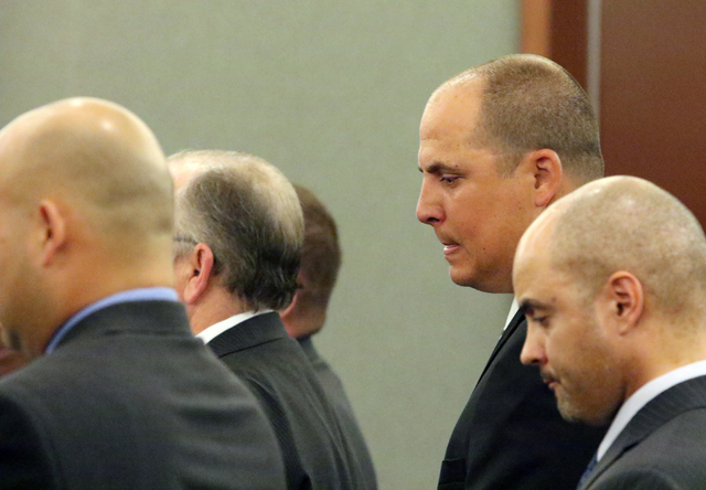 Jeffrey Martin, second from right, stands with his attorney Lucas Gaffney, right, in Judge Valerie Adair's courtroom at Regional Justice Center Tuesday, April 12, 2016, in Las Vegas. Martin was se ...