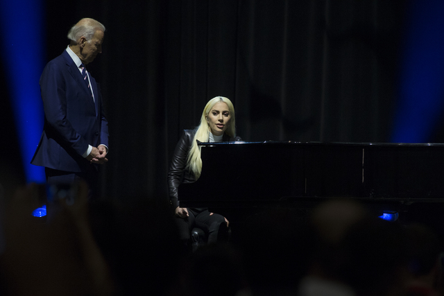 "Lady Gaga, right, and Vice President Joe Biden speak to the crowd after Gaga performing ""Til It Happens to You"" during an event aimed at preventing sexual assault on college campuses in coordinati ..."