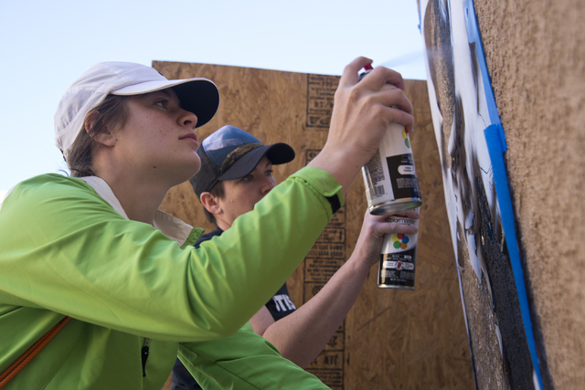 Stefania Ingramo, left, and Lora Feeoly work to paint a mural during a volunteer event held by the Gaels Give Hope organization from Bishop Gorman High School, benefitting a New Genesis Transition ...