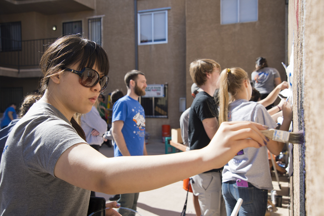 Michelle Jia works to paint a mural during a volunteer event held by the Gaels Give Hope organization from Bishop Gorman High School, benefitting a New Genesis Transitional Housing apartment compl ...