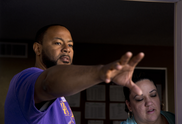 New Genesis Transitional Housing executive director Maurice Page talks with Tania Fernandez during a volunteer event held by the Gaels Give Hope organization from Bishop Gorman High School, benefi ...